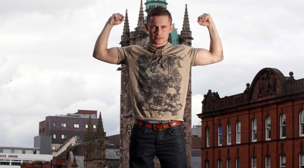Carl Frampton stands tall outside the Europa Hotel yesterday while looking ahead to his European Super-bantamweight title scrap against Kiko Martinez next month