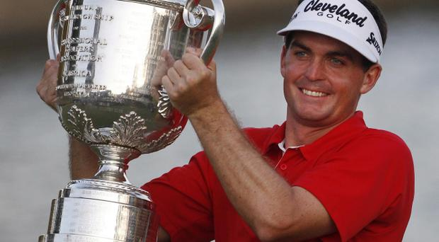 Keegan Bradley shows off the trophy following his US PGA triumph on Sunday night