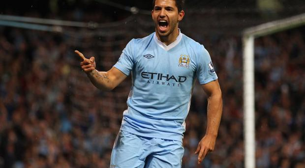 MANCHESTER, ENGLAND - AUGUST 15: Sergio Aguero of Manchester City celebrates after scoring the second goal during the Barclays Premier League match between Manchester City and Swansea City at Etihad Stadium on August 15, 2011 in Manchester, England. (Photo by Alex Livesey/Getty Images)
