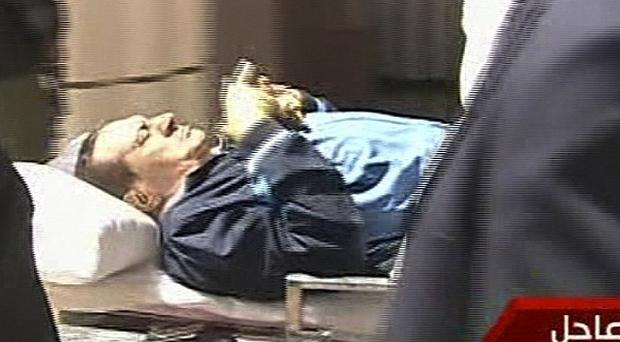 Video image showing former president Hosni Mubarak being wheeled into the court building in Cairo (AP/Egyptian State TV)