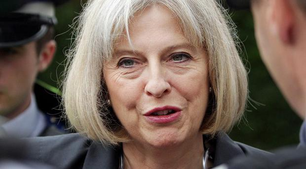 Police forces across England and Wales should be given clearer guidance on tackling riots, Home Secretary Theresa May is due to say