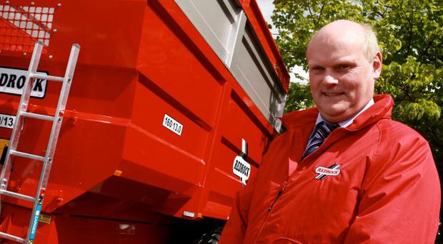 Managing Director of Redrock Machinery, Frank Flynn, with one of their products: