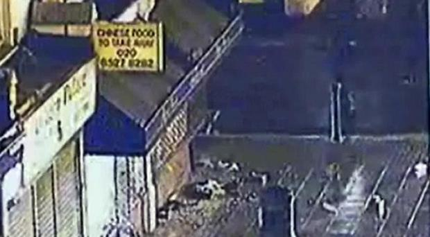 CCTV footage showing two police officers as they chased looters during last week's disorder (Metropolitan Police/PA)