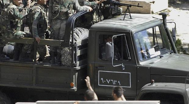 Government troops are in action in Latakia, residents say (AP)
