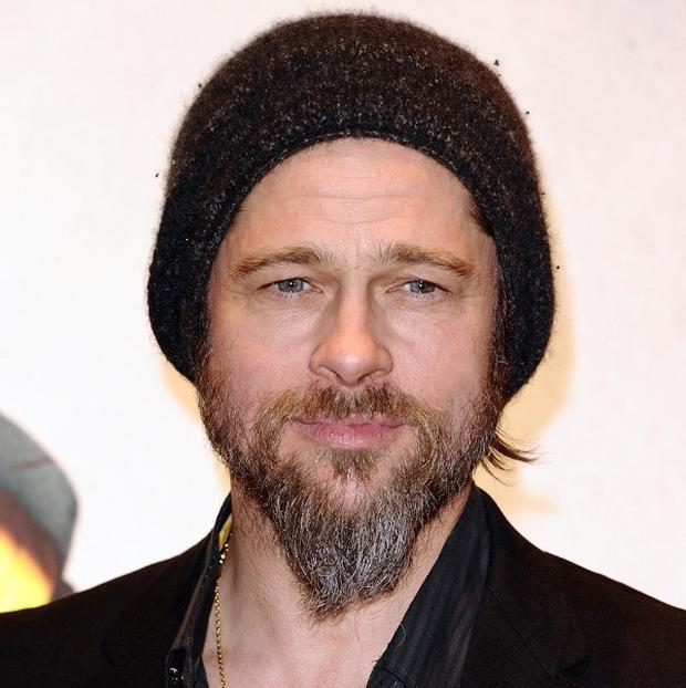 Hollywood star Brad Pitt arrived in Scotland by train to shoot scenes for a new zombie movie