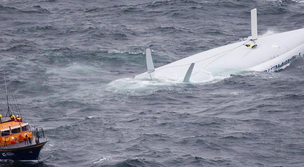 Racing yacht Rambler 100 capsized during the Fastnet Race (AP)
