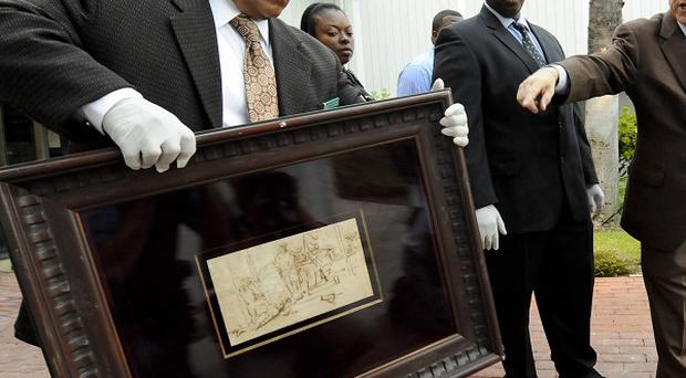 Los Angeles Sheriff detective Estevan Martinez with the recovered Rembrandt (AP)