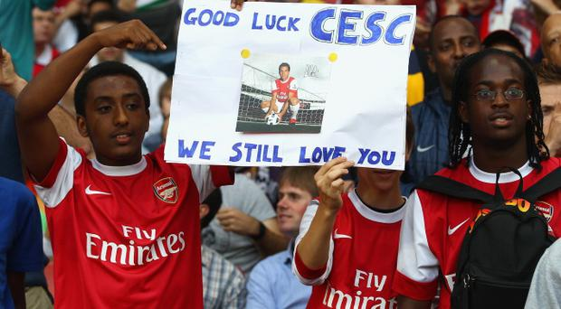 LONDON, ENGLAND - AUGUST 16: Arsenal fans show their support for former captain Cesc Fabregas ahead of the UEFA Champions League play-off first leg match between Arsenal and Udinese at the Emirates Stadium on August 16, 2011 in London, England. (Photo by Julian Finney/Getty Images)