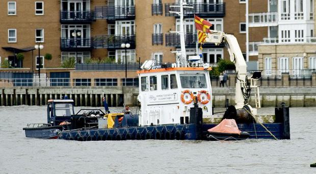 A search was launched after the Chieftain tugboat sank off Greenwich Pier in south London
