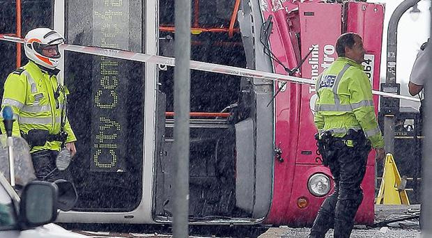 A number of people were hurt when a bus overturned outside Central Station in Belfast