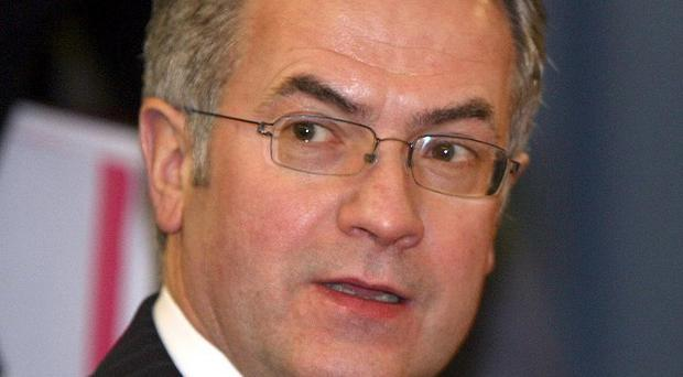 Emvironment minister Alex Attwood has held a summit on heritage crime