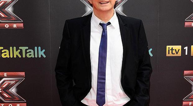 The new judges in the X Factor have given the show 'a whole new energy' according to veteran Louis Walsh