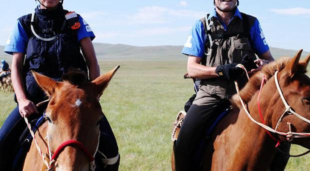 Northern Ireland Secretary Owen Paterson with his wife Rose who completed a 1,000km horse ride across Mongolia for charity