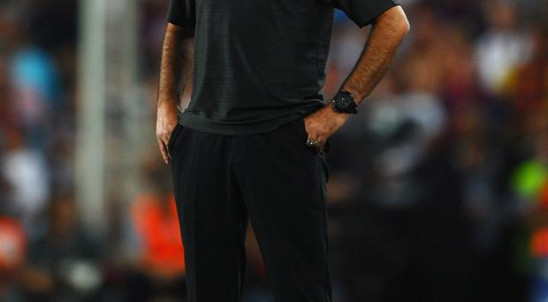 BARCELONA, SPAIN - AUGUST 17: Jose Mourinho of Real Madrid shows his frustrations during the Super Cup second leg match between Barcelona and Real Madrid at Nou Camp on August 17, 2011 in Barcelona, Spain. (Photo by Laurence Griffiths/Getty Images)