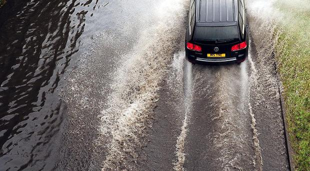 Vehicles have broken down and roads have been closed due to a sudden downpour in southern England