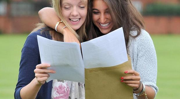 Alison Coxon (left) and Claire Abrahams excitedly read their A-level results at Withington Girls School in Manchester