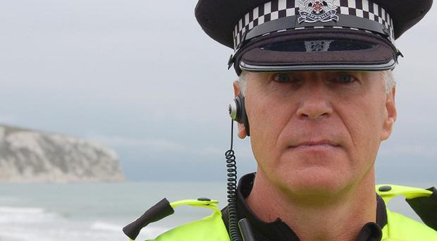 Inspector Colin Hall, of Hampshire and Isle of Wight police, at the scene where a man and woman were killed after their car went over the cliffs