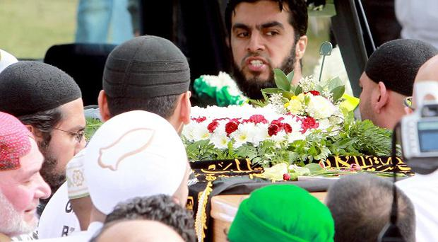 The coffins of Haroon Jahan, Shazad Ali and Abdul Musavir are loaded into their hearses before a private burial at Handsworth Cemetery