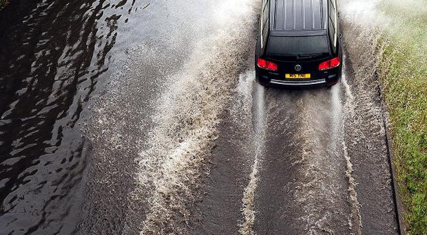Vehicles have broken down and roads were closed due to sudden heavy downpours in southern England