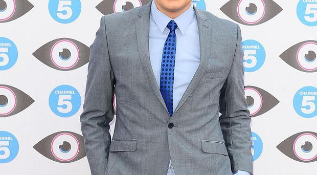 Brian Dowling steps into Davina McCall's shoes as presenter of Big Brother, which has migrated to Channel 5
