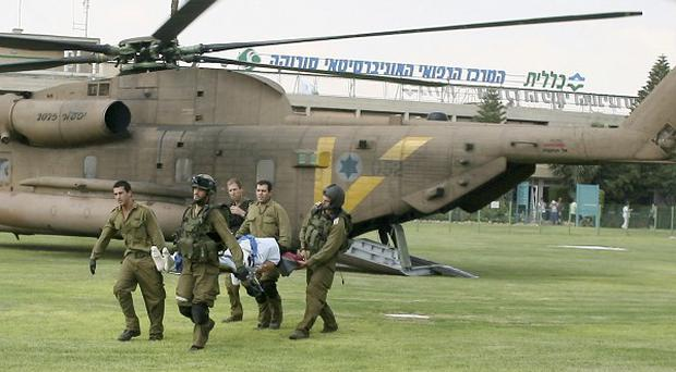 Israeli military medics evacuate a person wounded in one of several attacks in the Arava desert (AP)