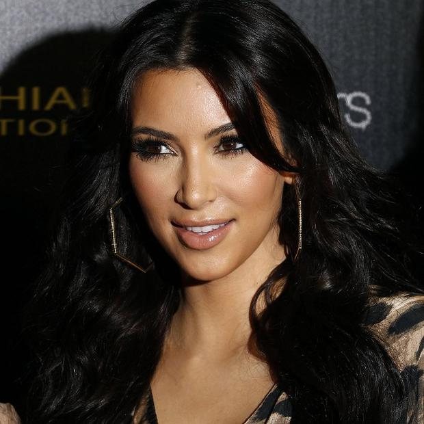 Kim Kardashian is set for a 'regal' wedding, according to Perez Hilton