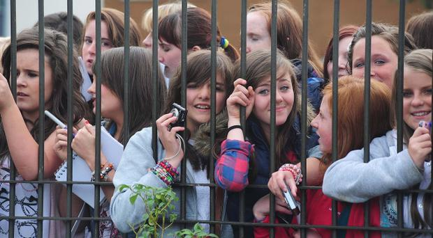 The crowd waits to catch a glimpse of boyband One Direction