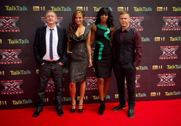 LONDON, ENGLAND - AUGUST 17: (L-R) Louis Walsh, Tulisa Contostavlos, Kelly Rowland and Gary Barlow attend a photocall for the X Factor at 02 Arena on August 17, 2011 in London, England. (Photo by Ian Gavan/Getty Images)