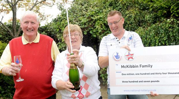 £1.1 million National Lottery winners Maire and Jarlath McKibbin and son John celebrating the win in their home village of Kilkeel, Co Down
