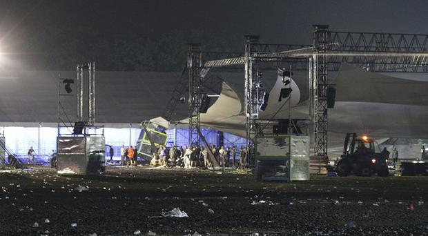 A storm swept through a Belgium music festival, killing five people and injuring 70 others (AP/Yves Logghe)