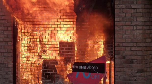 A man who spent nine days in custody charged with setting fire to a clothes store during rioting has been cleared of any wrongdoing
