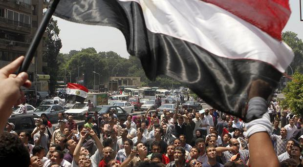 Hundreds of Egyptians shout anti-Israeli slogans outside the Israeli embassy in Cairo (AP)