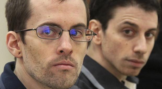 US hikers Shane Bauer, left, and Josh Fattal have been jailed for eight years in Iran (AP)