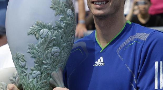 Andy Murray holds the trophy following the men's final against Novak Djokovic at the Western & Southern Open tennis tournament, Sunday, Aug. 21, 2011 in Mason, Ohio. Djokovic retired with a shoulder injury and Murray leading 6-4, 3-0