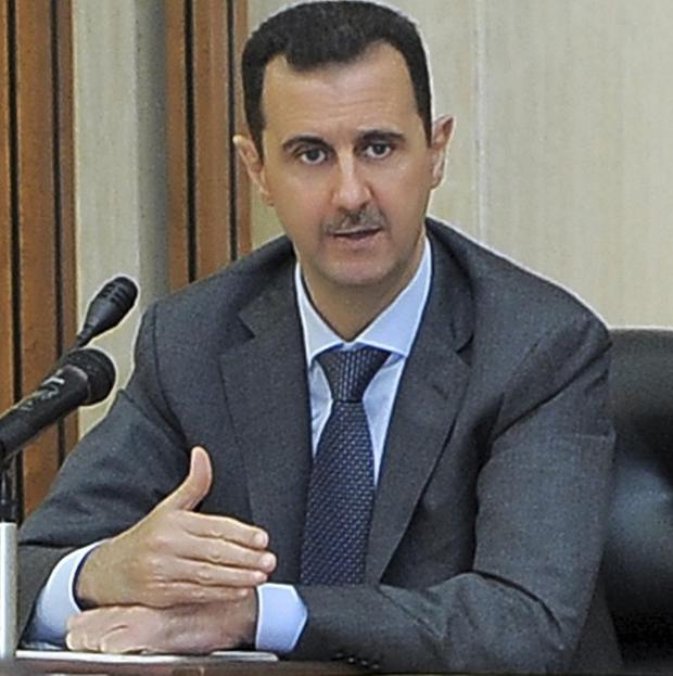 Syrian President Bashar Assad has insisted his regime is in no danger of collapse (AP/Sana)