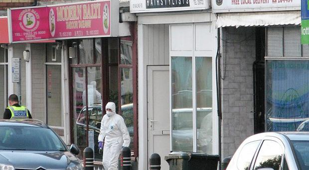 Scenes of crime officers outside Carol Ann's Hair salon in Newport where a shooting took place