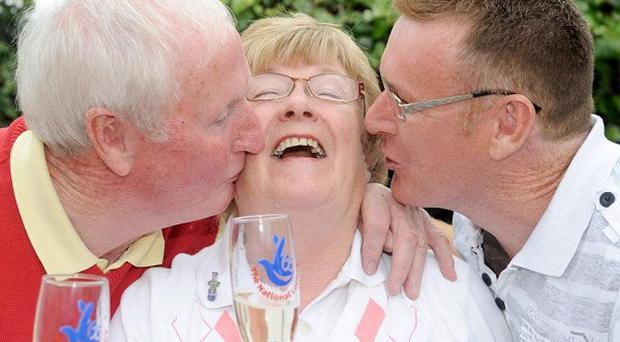 Maire and Jarlath McKibbin celebrate their lottery win with son John