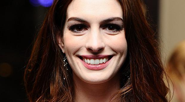 Anne Hathaway says getting into her Catwoman catsuit takes commitment