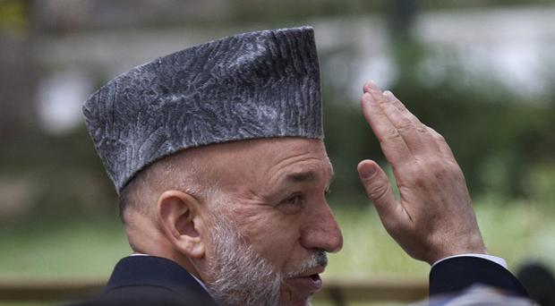 Afghan President Hamid Karzai has promised better protection for building workers who are being killed by insurgents trying to destabilise the country(AP)