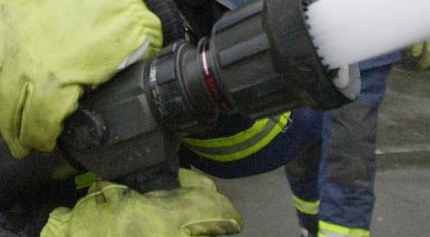 A two-year-old girl trapped in a bedroom by a house fire has been rescued
