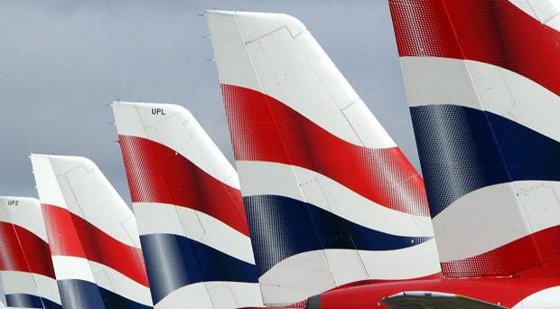 An American businessman has been arrested after allegedly threatening to stab the pilots on a British Airways flight