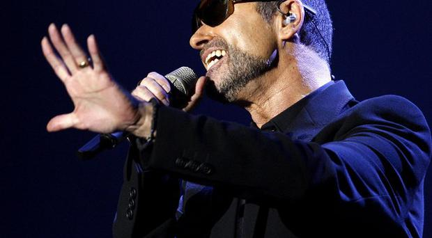 George Michael performs during his first Symphonica concert at the State Opera House in Prague (AP)