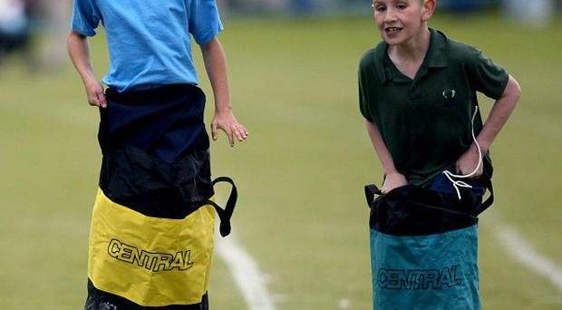 Sports day sack races have been hit by an 'epidemic' of health and safety excuses, the Government has said