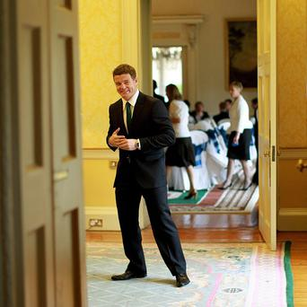Captain Brian O'Driscoll waits to greet President Mary McAleese at Aras an Uachtarain during a reception for the Irish Rugby Football Union team