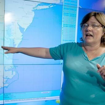 Seismologist Lucy Jones points to a map showing the Virginia earthquake epicentre (AP)