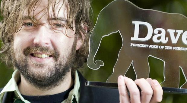 The Dave Funniest Joke of The Fringe 2011 award winner, Nick Helm, with the award in Edinburgh (Dave/PA)
