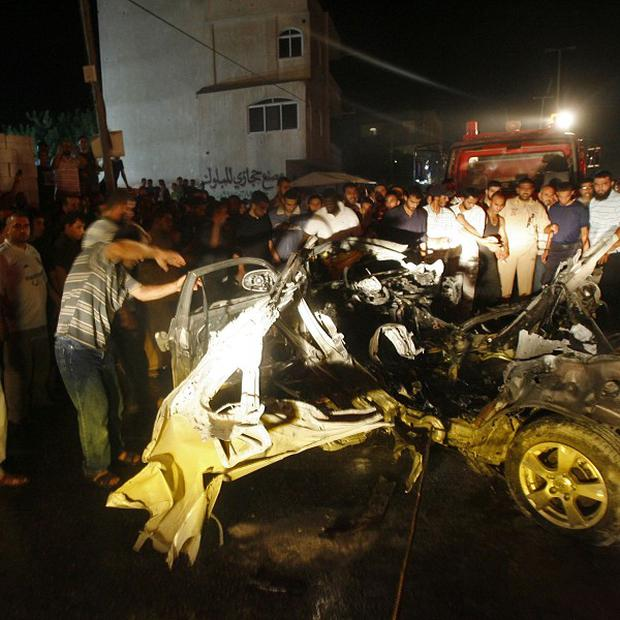 The wreckage of a car after it was hit by an Israeli missile in southern Gaza (AP)