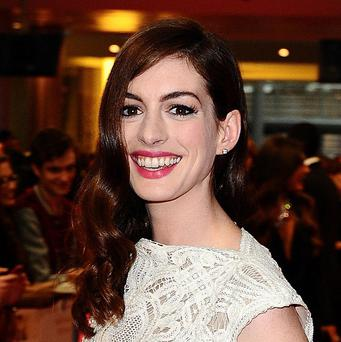 Anne Hathaway arriving for the premiere of One Day at the Vue Cinema White City