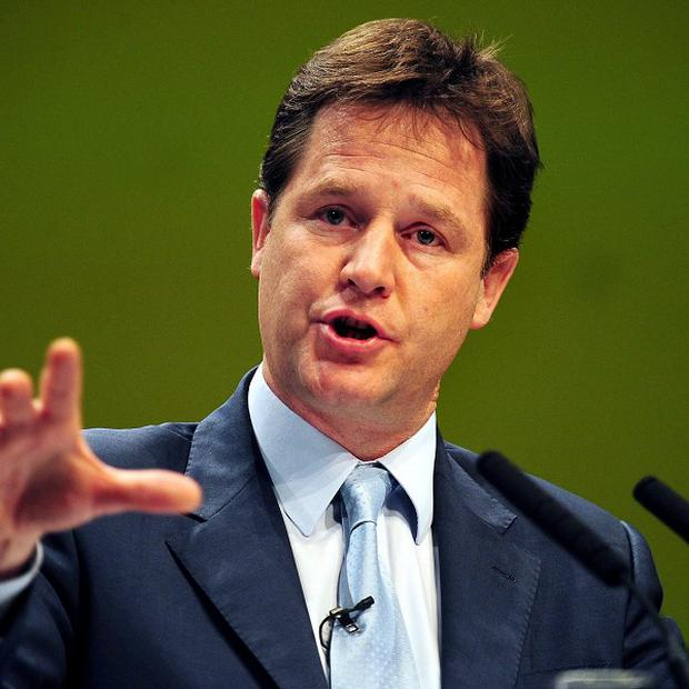 Deputy Prime Minister Nick Clegg was splattered with blue paint during a meeting in Glasgow