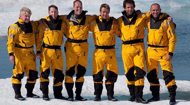 Explorer Jock Wishart, left, said he was 'exhilarated' after his crew became the first to row to the magnetic north pole